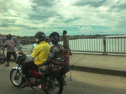 Young passenger on one of Benin's many Zemidjans