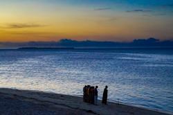 Praying by the beach, Stone Town, Zanzibar