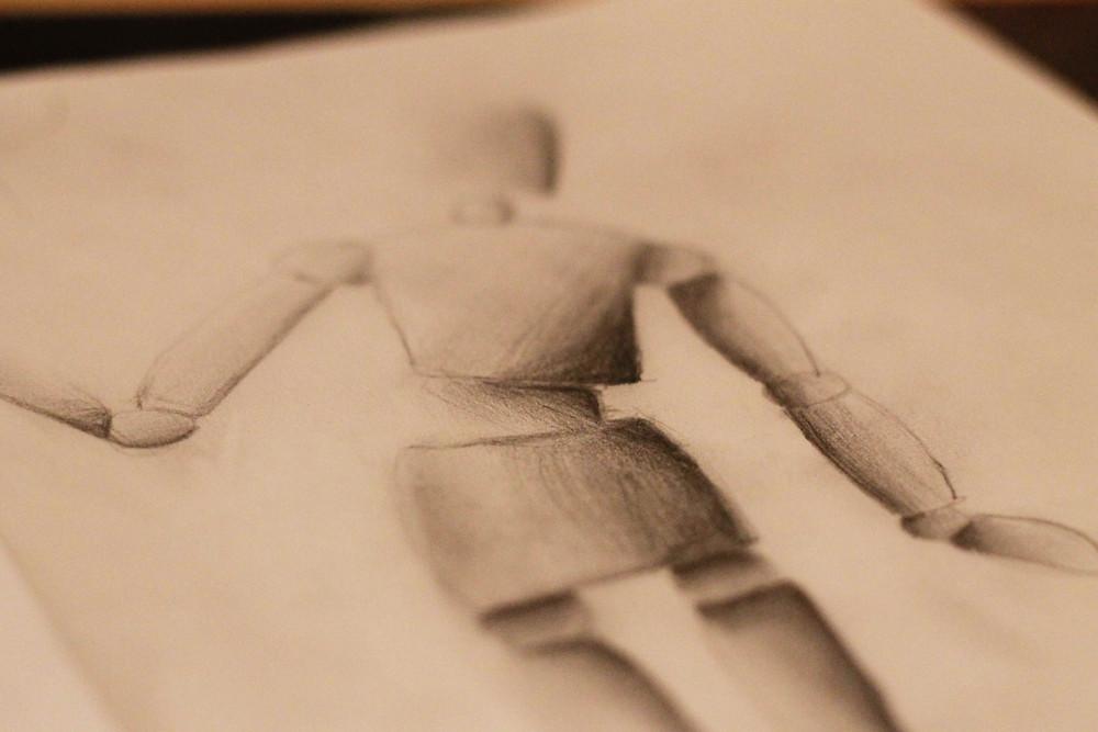 Ein nachgezeichneter Holzmensch
