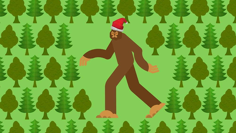 Bigfoot in the woods wearing a santa hat