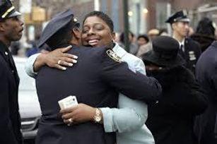officer hugging lady.jpg