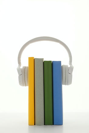 white-headphones-with-books-3394660.jpg