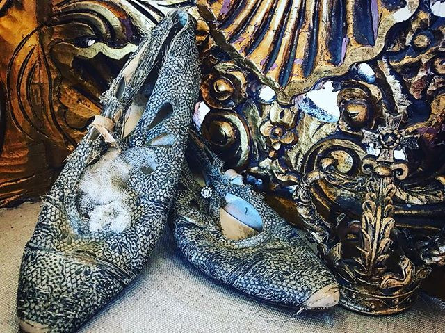 antqiue french shoes and carvings