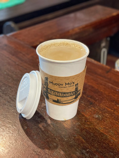 Get your coffee to go or stick around and enjoy it while you hang in the coffee house.