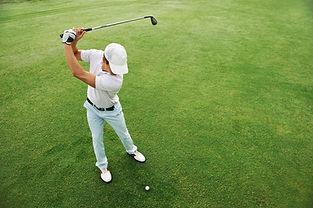High overhead angle view of golfer hitti