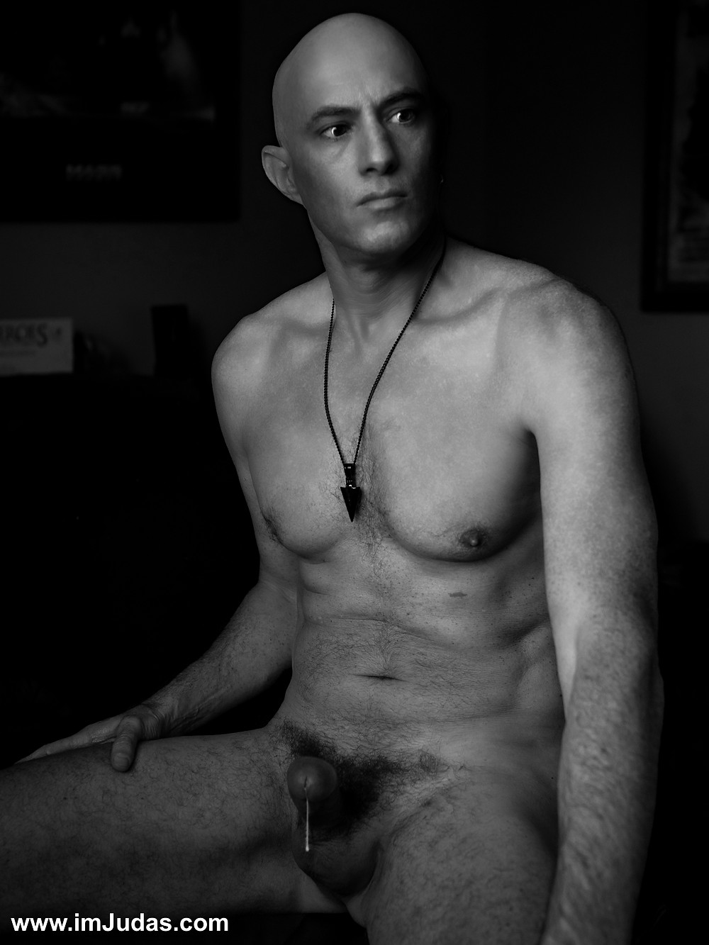 Naked, showing my cum dripping cock