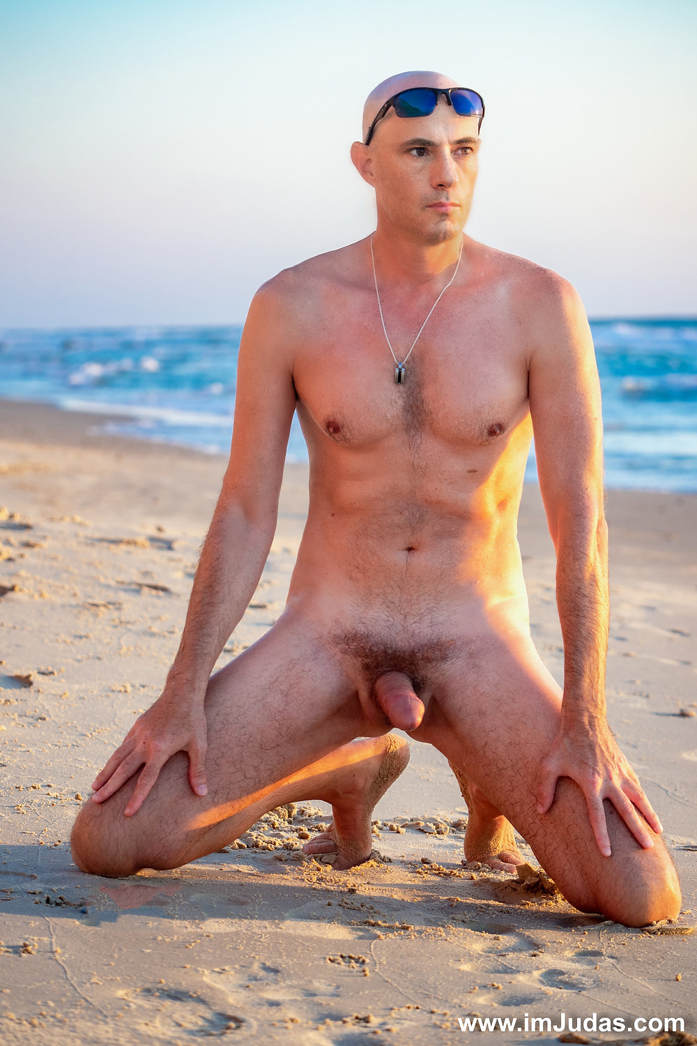 naked and hard at the beach