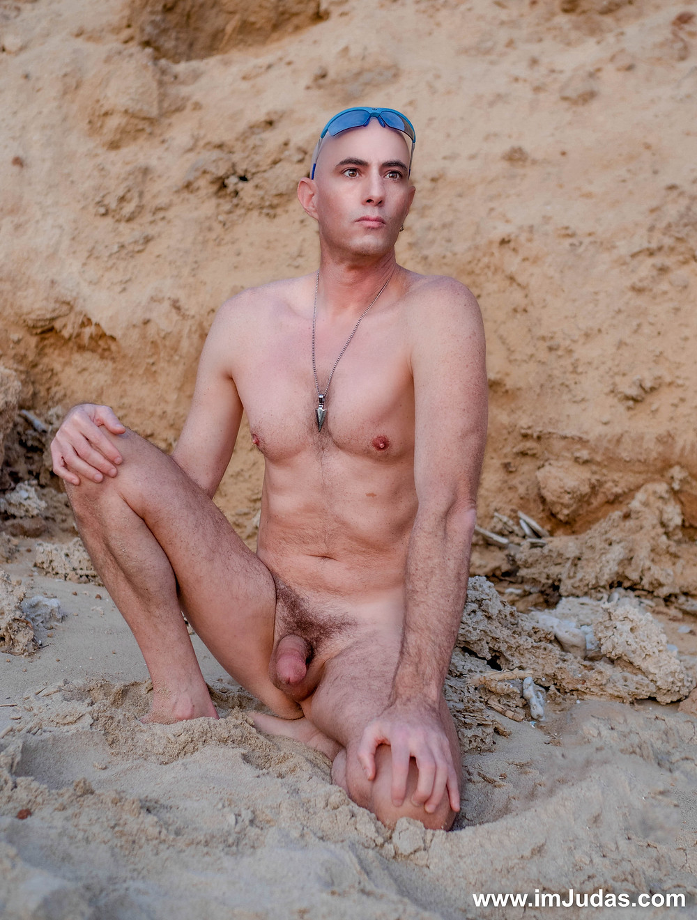 Naked at the beach, showing my cock