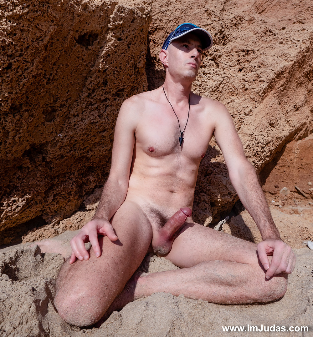 naked with a hard on at the beach