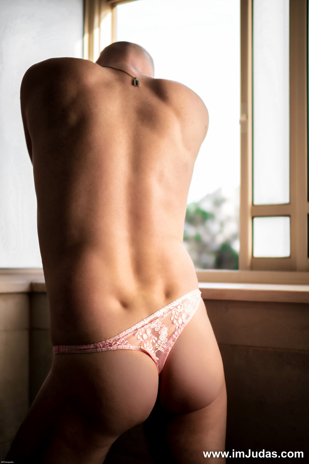 A man wearing a lace thong
