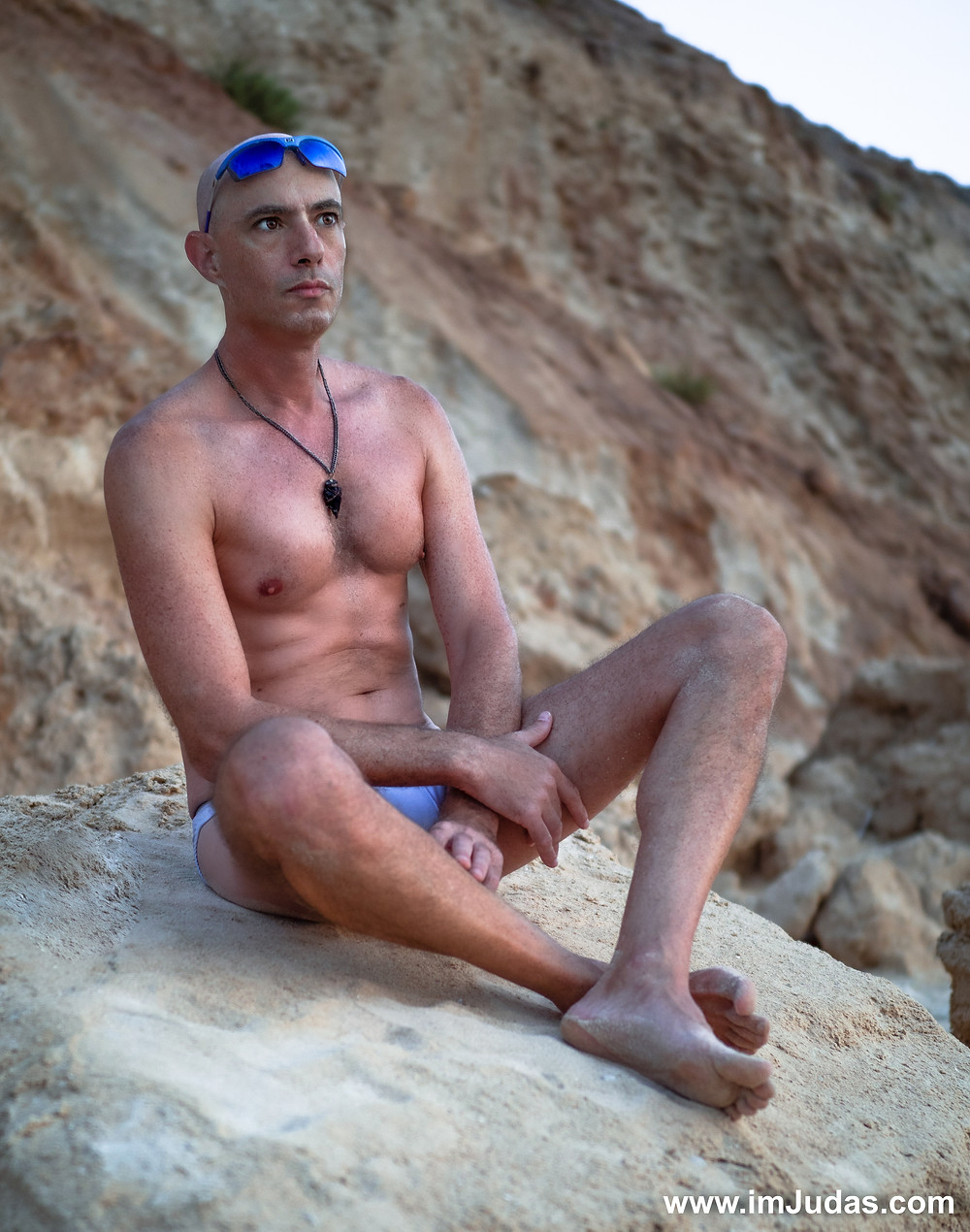 Wearing speedos at the beach, showing my large pecs