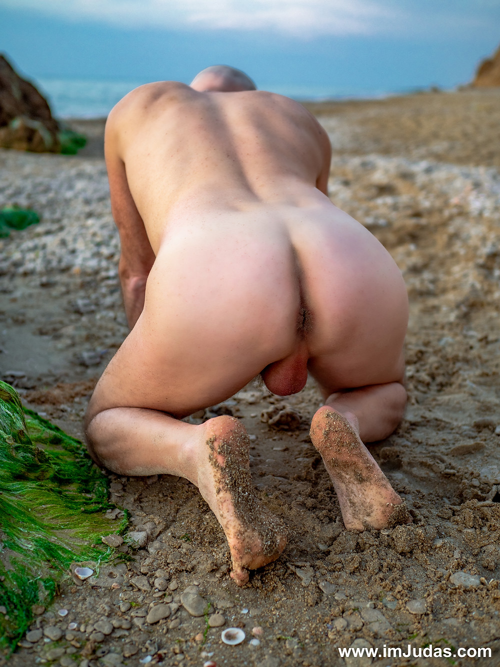 Naked in doggie at the beach, showing my ass hole