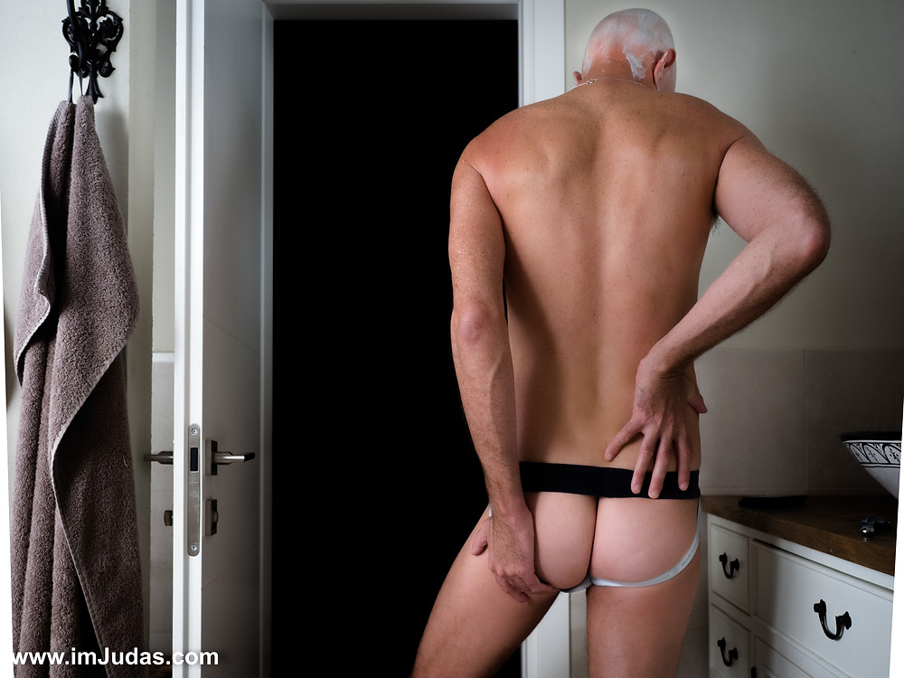 A guy in jocks showing his ass in the shower
