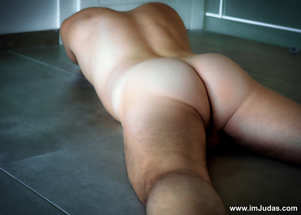 Naked on the floor, showing my ass