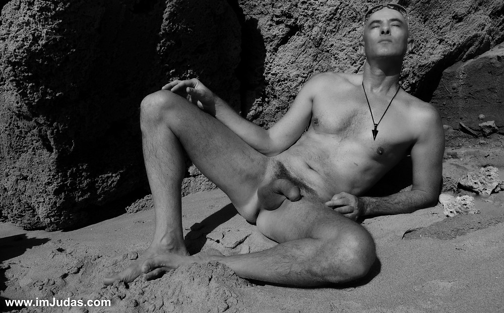 Naked at the beach, legs spread, showing my cock