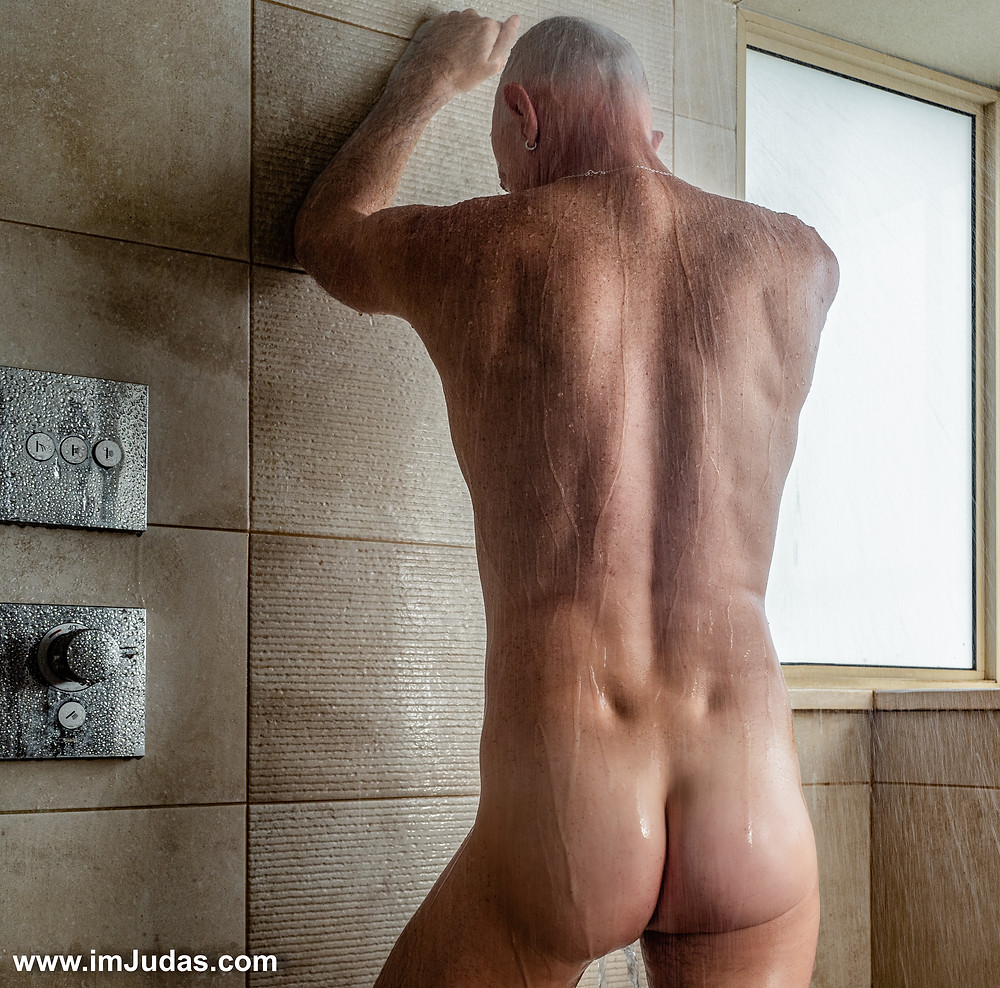 Naked in the shower, facing backward