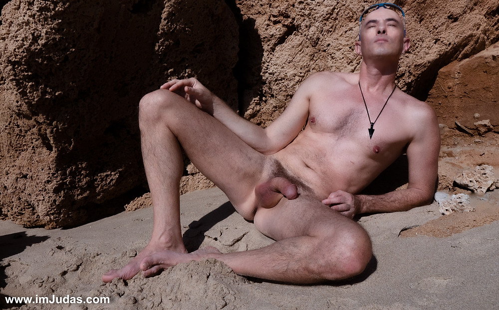 Naked guy at the beach