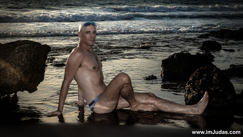 A guy wearing a speedo at the beach
