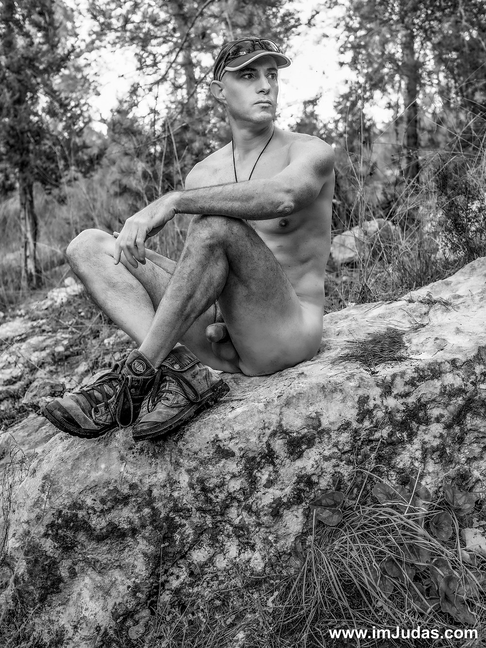 Sitting on a rock naked, my cock visible