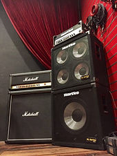 Marshall guitar amplifier and Hartke bass amplifier in our rehearsal room.