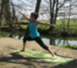 Lucia practicing yoga by the River Frome at Stowford