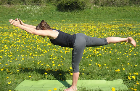 Lucia practicing Yoga in a meadow at Stowford