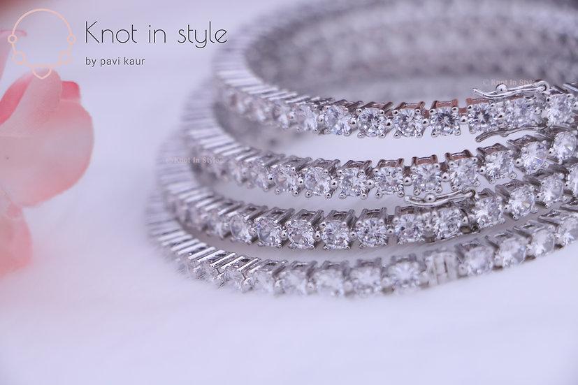 Diamond cut silver bangles (a pair)