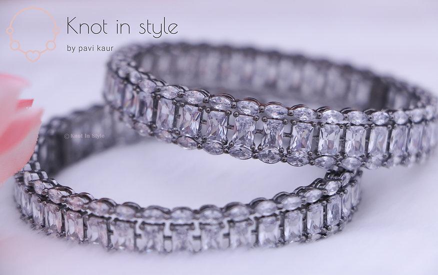 Diamond cut silver bracelets with rhodium polish (a pair)