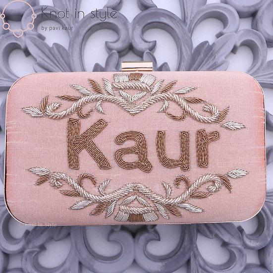 'KAUR' clutch