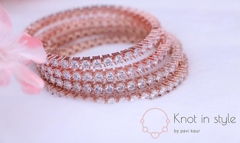 Diamond cut rose gold bangles (a pair)
