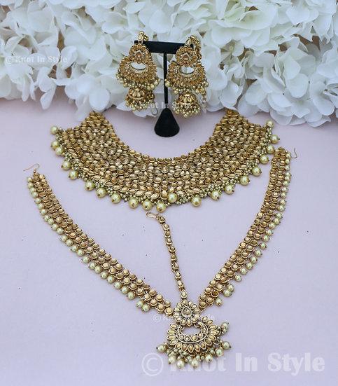 Golden kundan necklace set with matha patti