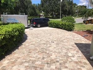 driveway paves sealing in progress