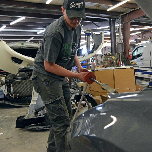 Man-Repairing-Car