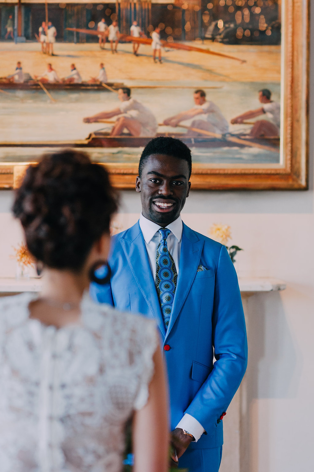 Groom at wedding ceremony in London Rowing Club