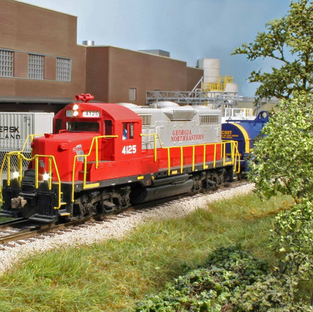 GNRR locomotive #4125, a GP20, rolls past Dow Chemical.