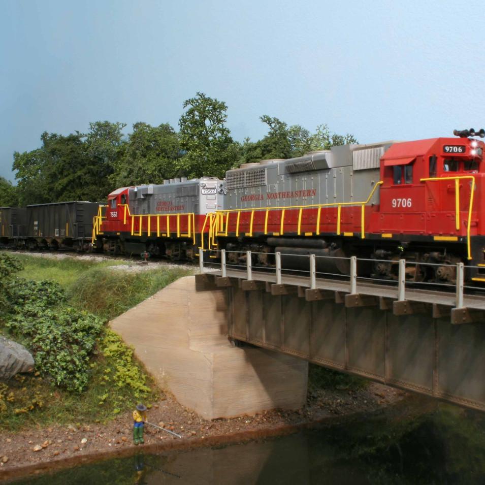 Lead by GNRR GP38 #9706, the Elizabeth Yard Turn crosses the Etowah River bridge.