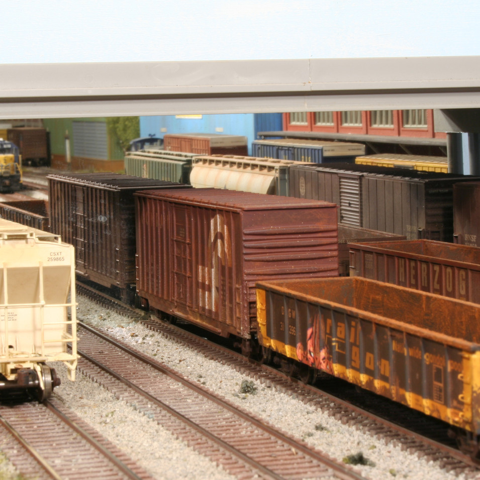 Various freight cars sit in the Hawksridge Yard awaiting assignment to a local train. A mirror under the bridge helps make the yard look larger.