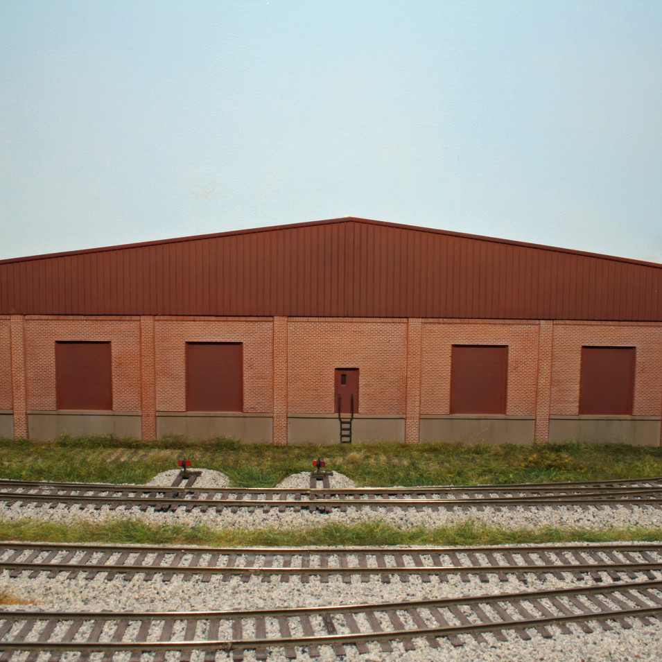 """The """"For Lease"""" building is no longer rail served with the rails removed from the ties."""