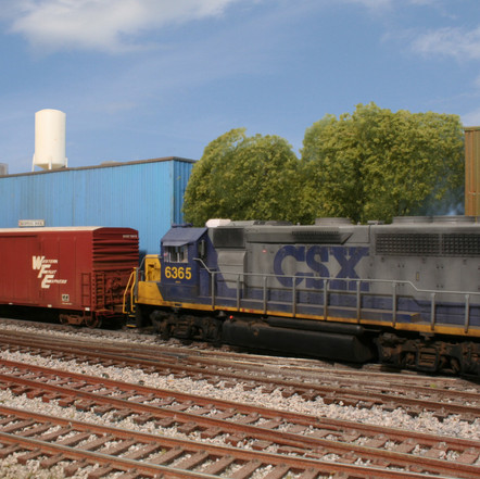 CSX locomotive #6365, a GP40-2, switches a refrigerated box car at Hawks Cold Storage. The industry is located adjacent to the Hawksridge Yard.