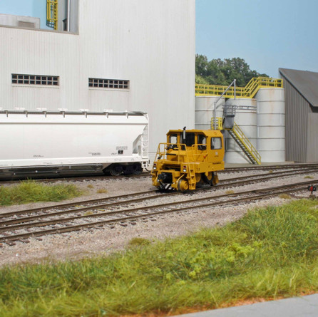 A Trackmobile is used at Imerys to move Pressureaide hopper cars.
