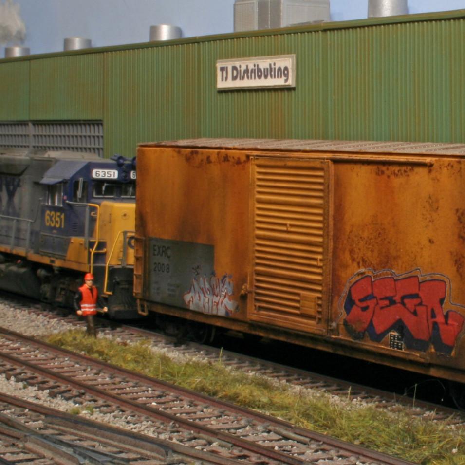 CSX locomotive #6351, a GP40-2, spots a box car at TJ Distributing.