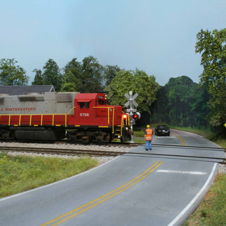 GNRR GP38 #9706 crosses Highway 53 in Tate under the watchful eye of the conductor.