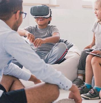 male teacher teaching students with VR.jpg