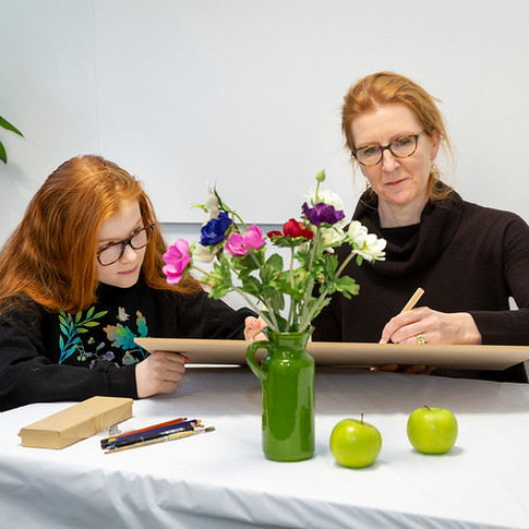 Mum and daughter drawing a still life