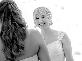bride-smiling-at-bridesmaid-before-wedding-in-cardiff-south-wales.jpg