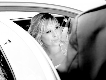 bride-getting-out-of-wedding-car-canada-lake-lodge-south-wales.jpg
