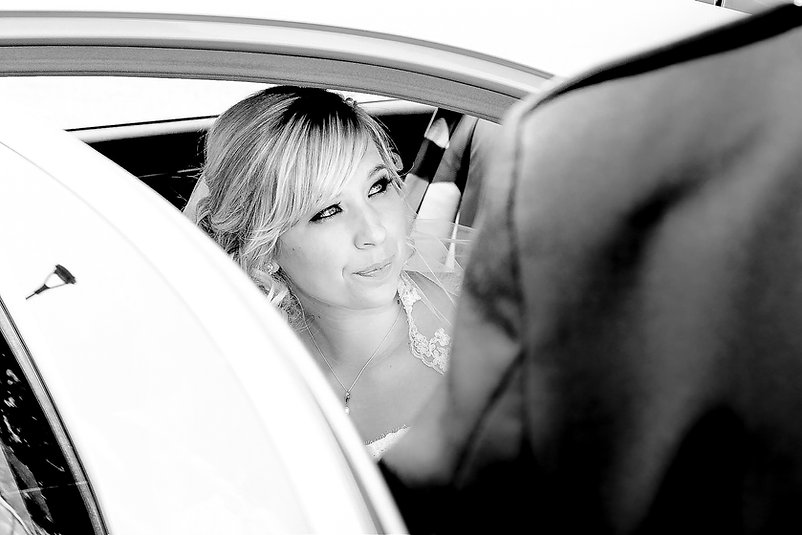 A bride getting ready to exit the wedding car as she arrives for the ceremony at Canada Lodge and Lake near Cardiff, South Wales