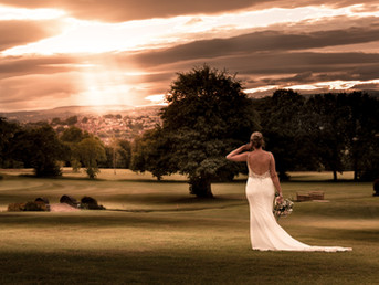 elegant-bride-posing-during-stunning-sunset-in-wedding-dress-at-bryn-meadows-in-south-wale