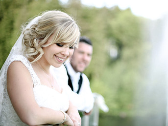 bride-smiling-with-groom-in-background-canada-lake-lodge-south-wales.jpg