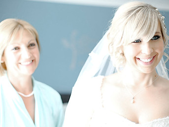bride-smiling-with-her-mother-on-wedding-day-in-cardiff-south-wales.jpg